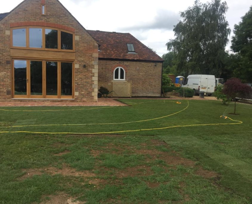 Completed drainage work for a property, including re-turfing